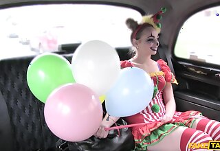 Kinky chick dressed as a clown enjoys riding a taxi driver's dick