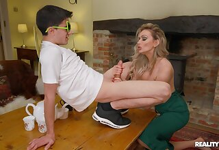 Sophisticated blonde MILF Amber Jayne enlightens a younger person