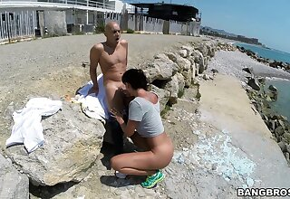 Moot unspecified Franceska Jaimes blows a stranger on the beach