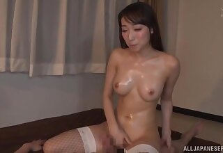 Oiled Japanese hottie enjoys getting fucked in doggy + cum on boobs
