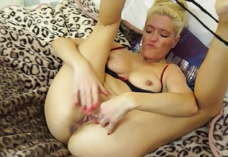 Mature blonde amateur solo model Judy masturbates in the shower
