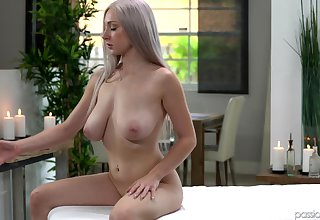 Oiled Skylar Vox spreads the brush legs for a penis surpassing the rub-down table