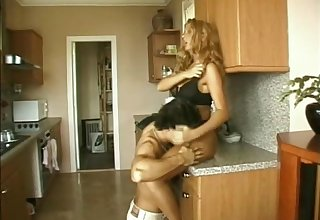 Naughty porn cowgirl gets fucked hard doggystyle in the matter of the kitchen