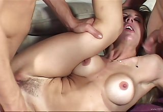 Big tit babe is glad to serve these two bodies in a dank threesome