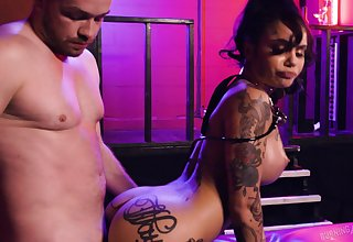 Tattooed slut Genevieve Sinn with big fake tits gets fucked hard