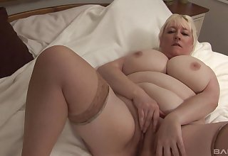 Busty mature blonde clumsy gets naked increased by plays with her cunt