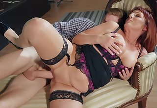 Redhead mommy sits wearing her hot lingerie, enduring sex distance from behind
