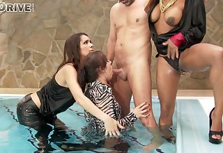 Interracial group sex by the pool with clothed pizazz pornstars