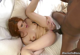 The big black dick suits this ginger's pussy just of the first water